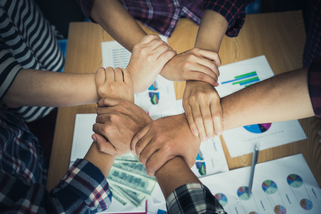 four-hand-together-business-meeting-team-concept_39408-1884